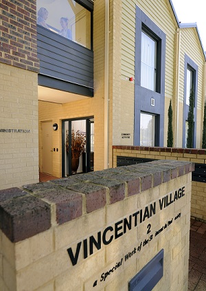 The street entrance to Vincentian Village, a two-story brick building, which is bright and welcoming.