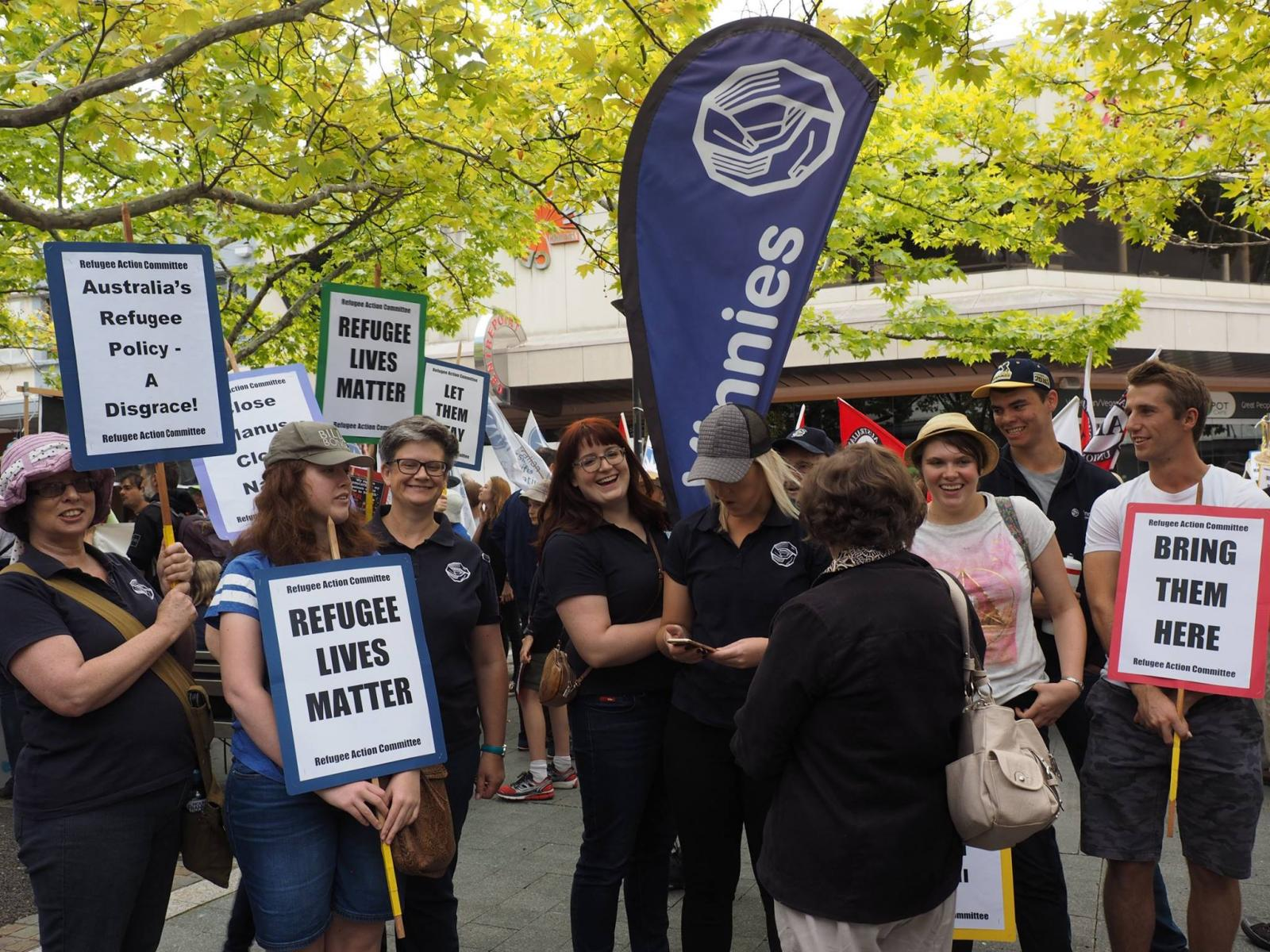 Supporters of the St Vincent de Paul Society in Canberra marched for refugees at a Palm Sunday Rally.